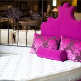 The fuchsia bed frame and head-board for the granddaughter's guest bedroom were designed by Outre and provided by Holder Mattress, both located at the Indiana Design Center. Holder Mattress is open to the public.