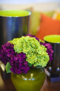 Add color quickly with accessories.  This potted arrangement and urns are from The Trade Connection.