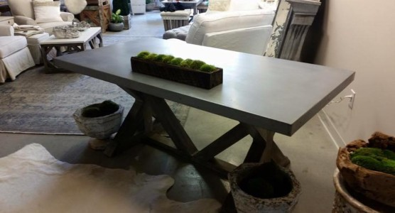 Zinc top table with cross base.