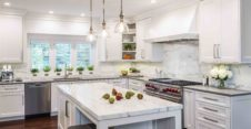 Multiple prep and cooking zones allow for the whole family to participate in meal preparation. Kitchen design by Conceptual Kitchens & Millwork.