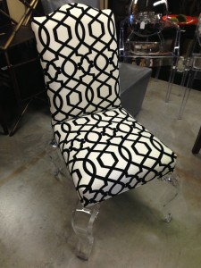 Black and white camel back chair with acrylic legs