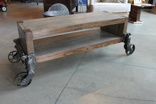 Poplar and oak coffee table with antique casters from factory carts.