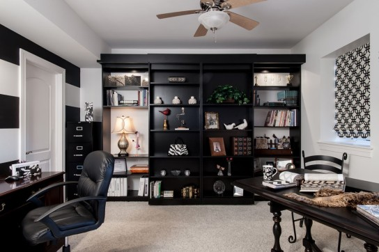 Versatility in a guest room/office. Functional bookcases provide storage.