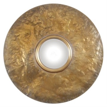 A convex mirror surrounded by a hammered metal frame in an oxidized metal revealing a soft gold finish.