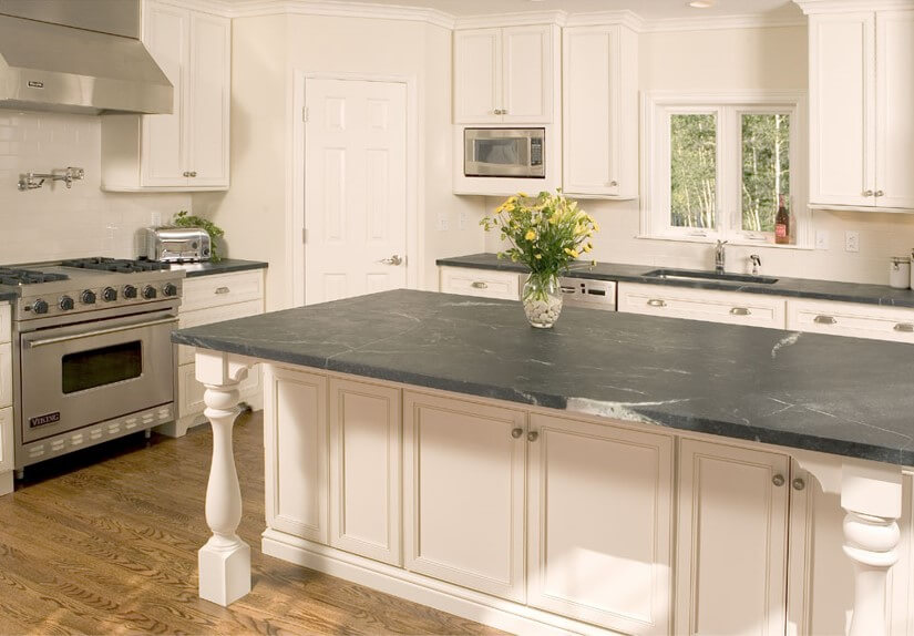 Soapstone island and perimeter counters from the design portfolio of Santarossa.