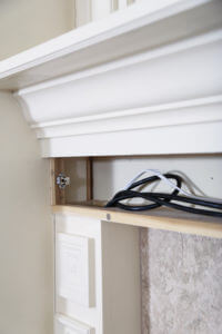 Hidden wires incorporated behind trim work creates a clean and seemless look.