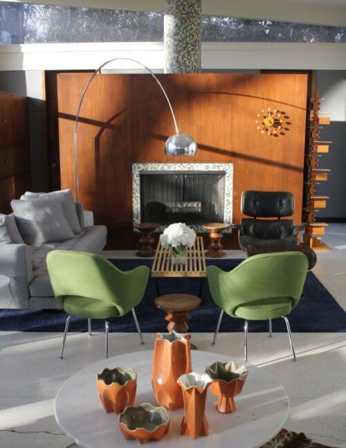 Living room design by Design Studio Vriesman with green Knoll Saarinen Executive chairs.